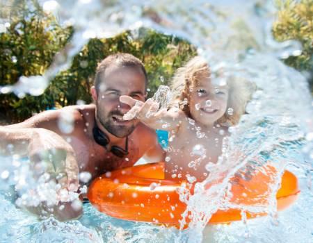 Father and Son in Los Sueños Beach Club Pool