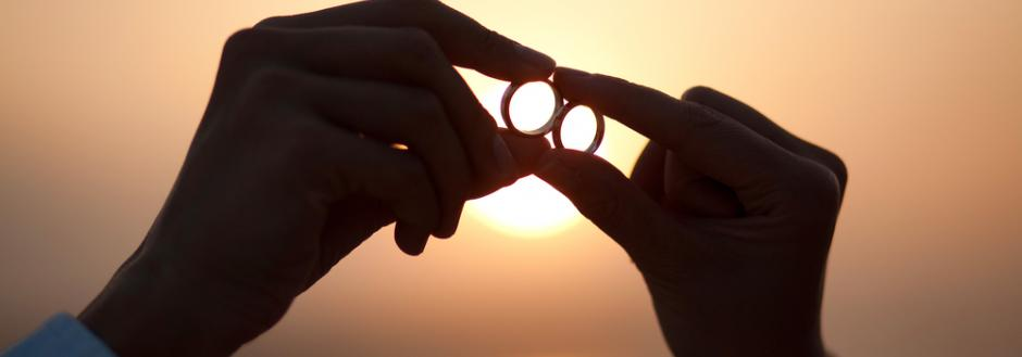 wedding rings and Costa Rica beach sunset