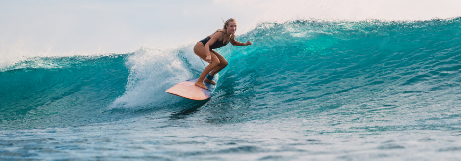 Woman surfing in Costa Rica